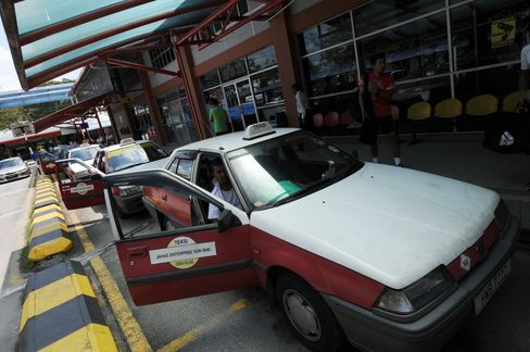 Free Tires for Malaysian Cabs Expose Budget Risk as Vote Looms