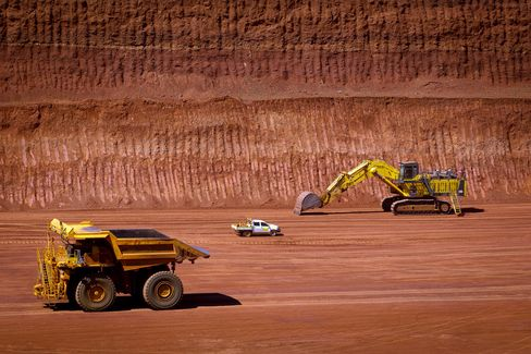 Rio Said to Pursue $5 Billion Iron-Ore Project as Glut Looms