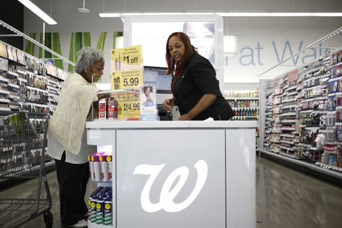 A Customer is Served at a Walgreen Co. Store in Louisville