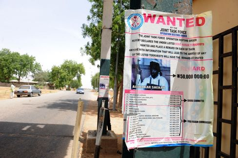 """A poster displayed along the road shows photograph of the leader of the militant Islamist group Boko Haram in Nigeria. A variety of extremist organizations operate in Africa, from al-Shabaab in Somalia and the Movement for Openness and Jihad in West Africa to al-Qaeda in the Islamic Maghreb and organizations such as Boko Haram in Nigeria, which began as a domestic terrorist group """"but is now engaged in regional activity against Cameroon and Niger,"""" said Johnnie Carson, a former U.S. assistant secretary of state for African a"""