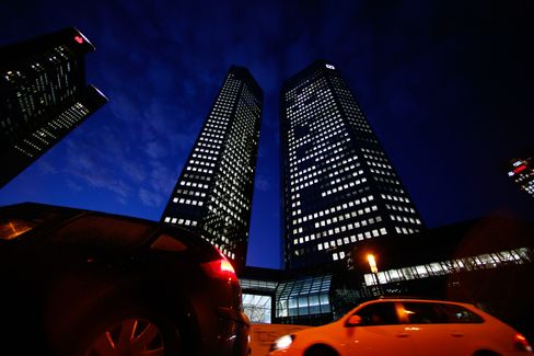Traffic passes the illuminated headquarters of Deutsche Bank AG in Frankfurt. Deutsche Bank has ranked among the top three underwriters of international bonds, excluding self-led deals, since at least 2002 and is first this year, data compiled by Bloomberg show. Photographer: Ralph Orlowski/Bloomberg