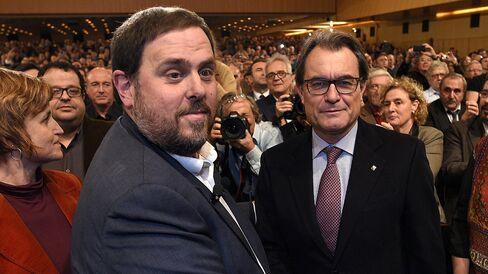Esquerra Republicana leader Oriol Junqueras with Catalan President Artur Mas in Barcelona on December 2, 2014. Photographer: Lluis Gene/AFP via Getty Images