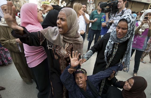 Egyptians react to the death sentence of a leader of the Muslim Brotherhood. Photographer: Khaled Desouki/AFP/Getty Images