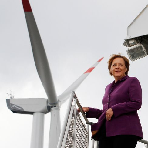 Angela Merkel, Germany's chancellor, stands at the entrance to a wind turbine tower at the Wind-projekt Ingenieur- und Projektentwicklungsgesellschaft mbH wind farm in