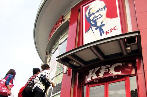 Third-quarter profits at Kentucky-based Yum! Brands Inc., owner of the Taco Bell and KFC fast-food chains, topped analysts' estimates on sales gains in the U.S. and China. Photographer: Imaginechina via AP Photo