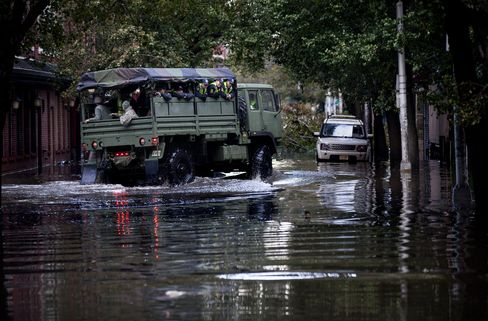 Hoboken Residents Wade Through City as National Guard Arrives
