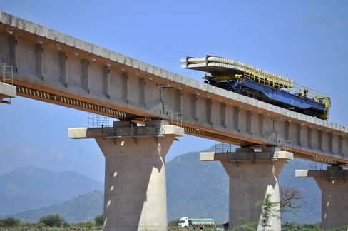 A wagon carries railway sleepers on a superbridge which will form part of the railway