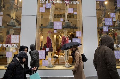 Pedestrians Pass Retail Stores On 5th Avenue in New York