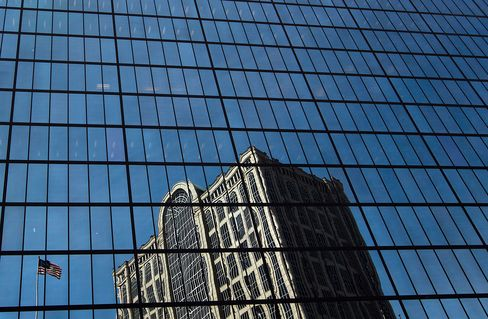 A building is reflected in the John Hancock Tower, Bain Capital LLC's headquarters in Boston, Massachusetts.