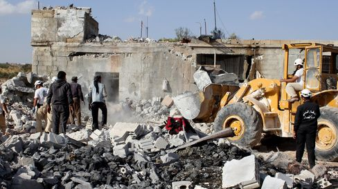 Wreckage of buildings are seen at the site of the alleged Russian airstrikes targeting the Jabal al-Zawiya town of Idlib, Syria on Saturday, Oct. 3, 2015. Photographer: Stringer/Anadolu Agency via Getty Images