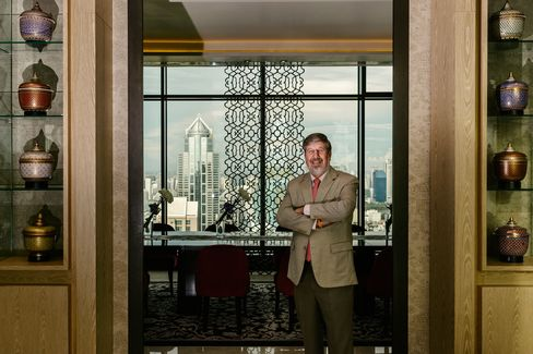 From his Bangkok penthouse, billionaire Bill Heinecke has witnessed the turmoil roiling his adopted country of Thailand. His money is on the kingdom surviving the tumult, including a coup in May.