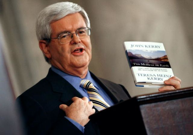 Former HouseSpeaker Newt Gingrich holds up a copy of 'This Moment on Earth,'by John Kerry and Teresa Heinz Kerry. During a debate on global climate change in April 2007, Gingrich said he agreed with about 60 percent of the book's conclusions.