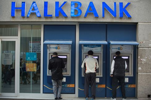 Customers Use ATMs at Halbank in Istanbul
