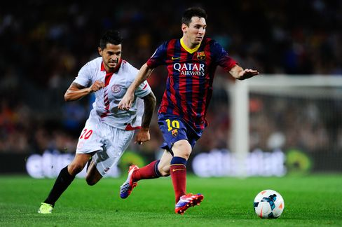 Lionel Messi, right, the four-time global player of the year for Barcelona, makes an estimated $41 million annually. Photographer:  David Ramos/Getty Images