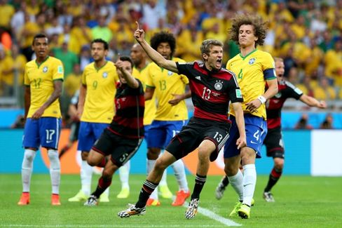 Thomas Müller of Germany celebrates scoring his team's first goal during their 2014 FIFA World Cup Semi Final match against Brazil.