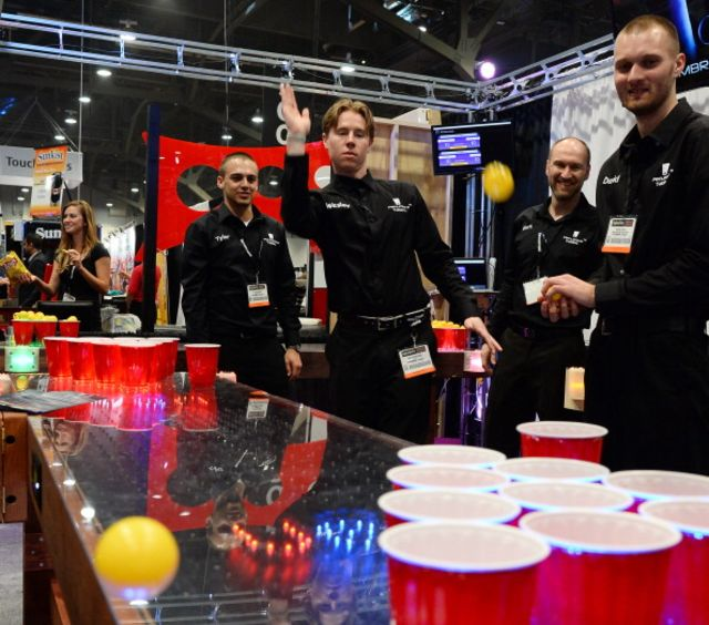 Not Libor manipulators. Possibly not even bros. But guys playing beer pong anyway. Photographer:Ethan Miller/Getty Images for Nightclub & Bar Media Group