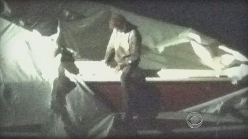 Police captured Tsarnaev hiding in a boat behind a house in Watertown, Massachusetts, after an almost 24-hour manhunt that shut down Boston and surrounding cities. Source: CBS News via Bloomberg