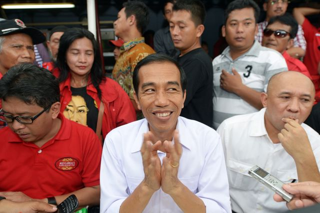 Joko Widodo needs more than hope and a smile to win in Indonesia. Photographer: Adek Berry/AFP/Getty Images