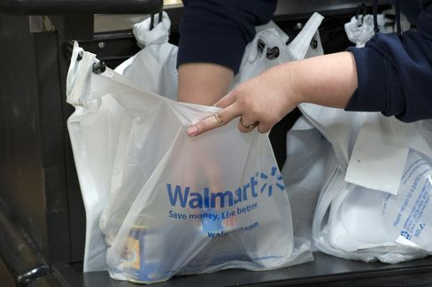 Wal-Mart Elevates 70,000 Workers Amid Empty-Shelf Complaints