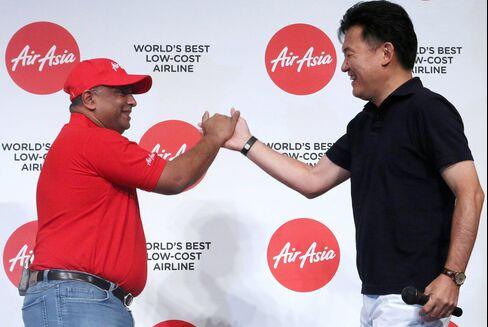 Tony Fernandes and Hiroshi Mikitani