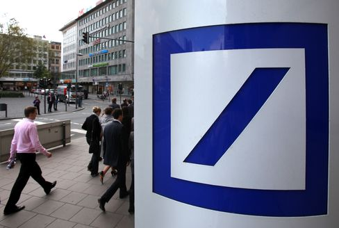 Pedestrians pass a Deutsche Bank AG logo at one of the bank's branches in Frankfurt, Germany. European banks say they have to cut assets to help satisfy a government push to boost capital faster than planned to insulate them against the sovereign debt crisis. Photographer: Hannelore Foerster/Bloomberg