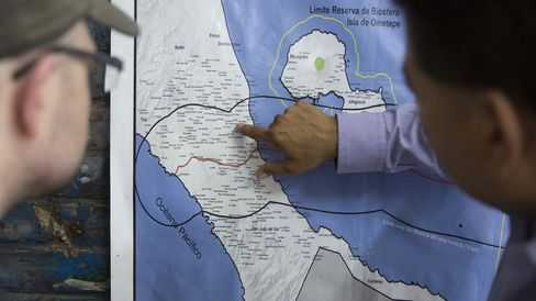A man points out the towns that will be affected where the canal, red line, will be built across Nicaragua.