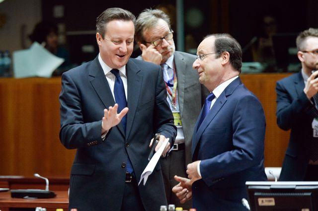 British Prime Minister David Cameron, left, and French President Francois Hollande can act on their own against Russian President Vladimir Putin. Photographer: Frederic Sierakowski/Photonews via Getty Images