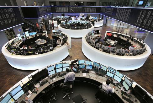 Traders work in front of the DAX index curve
