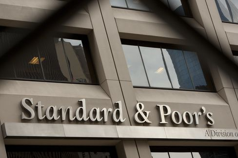 The Standard & Poor's Financial Services LLC logo is displayed in front of the company's headquarters in New York. Photographer: Scott Eells/Bloomberg
