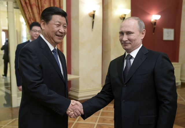 Chinese President Xi Jinping should separate from Russian President Vladimir Putin on Ukraine. Photographer: Alexei Nikolsky/AFP/Getty Images