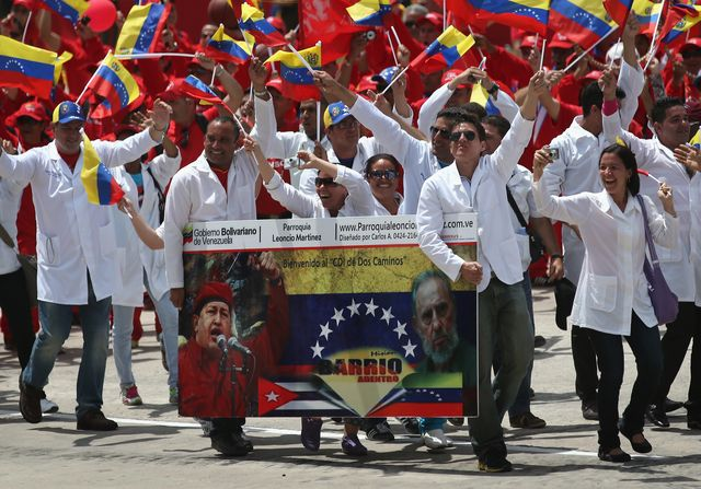 Celebrating Chavismo, high inflation and a shortage of food. Photographer: John Moore/Getty Images