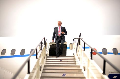 Boeing Co. Chief Executive Officer Jim McNerney walks out from a Boeing 787 Dreamliner aircraft upon its arri