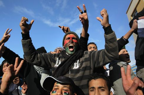 Demonstrators demand the removal of Libyan leader Muammar Gaddafi in Benghazi.  John Moore/Getty Images