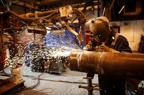 A Worker Welds a Connector Pipe at a Plant in Montrose