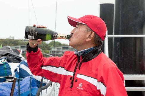 Billionaire Karl Kwok celebrates his yacht Beau Geste's win at the 2015 Audi Hamilton Island Race Week.