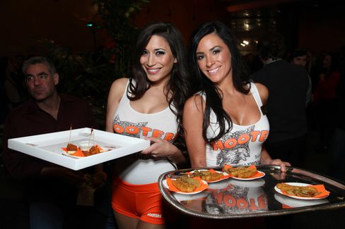 Hooters Targets Women as Tight Orange Shorts Still Rule