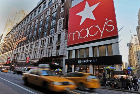 Taxis Drive Past Macy's Inc. Flagship Store in New York