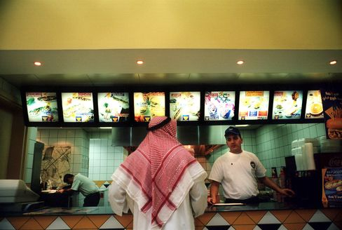 Saudis Buy Burgers With Royal Handouts in Boom Luring Carlyle