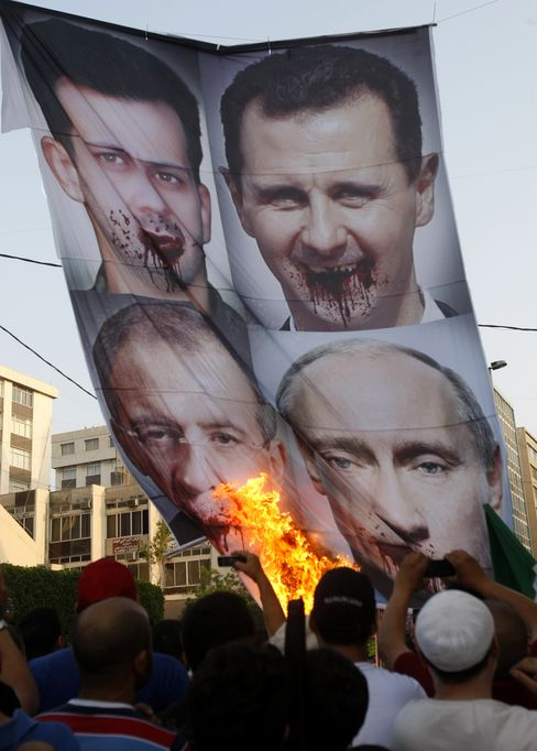 Syrian Deal Lacking Call for Assad Exit Seen as Win for Russia