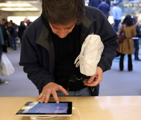 A shopper looks at an iPad