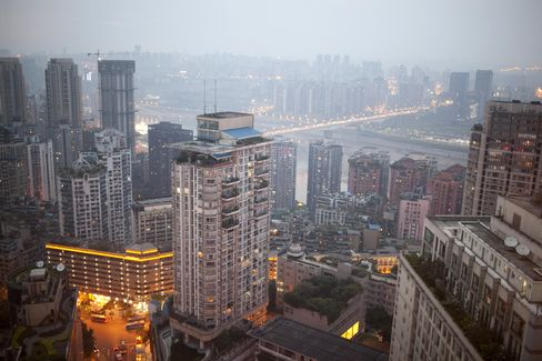 Buildings are lit at night in Chongqing, China. Photographer: Nelson Ching/Bloomberg
