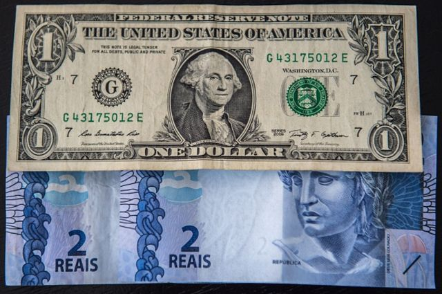 <p>A record four reals to the U.S. dollar.</p> Photographer: Christophe Simon/AFP/Getty Images