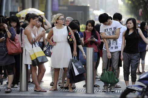 Singaporeans Plan Protest as Parliament Debates Population Boost