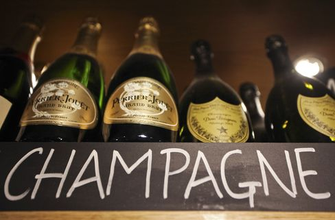 Bottles of Champagne Sit in a Bar in London