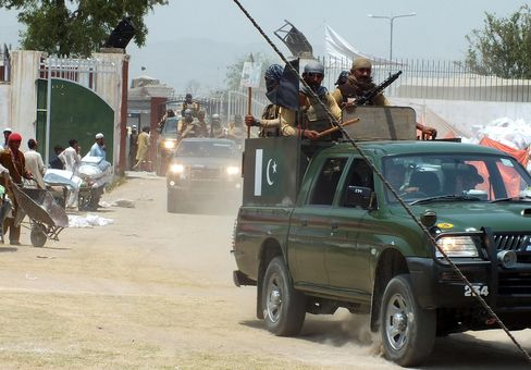 Pakistani Troops Patrol a Relief Distribution Point