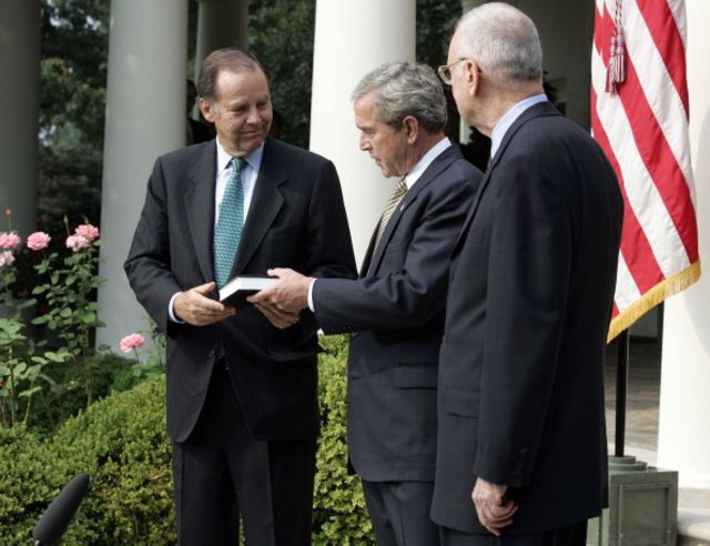 President George W. Bush received the 9/11 Commission's final report from Chairman Thomas H. Kean and Vice Chairman Lee H. Hamilton in the Rose Garden of the White House on July 22, 2004.