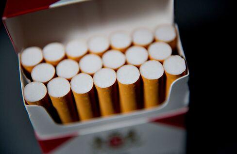 Philip Morris Cuts 2012 Earnings Forecast on Currency Swings