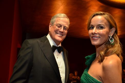 Koch Industries Executive Vice President David H. Koch, left, poses for a photo with Julia Koch during the opening night at the Metropolitan Opera in New York on Sept. 26, 2011. Photographer: Amanda Gordon/Bloomberg