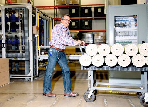 Desai with a load of reverse osmosis water filters at the manufacturing facility in Edina.