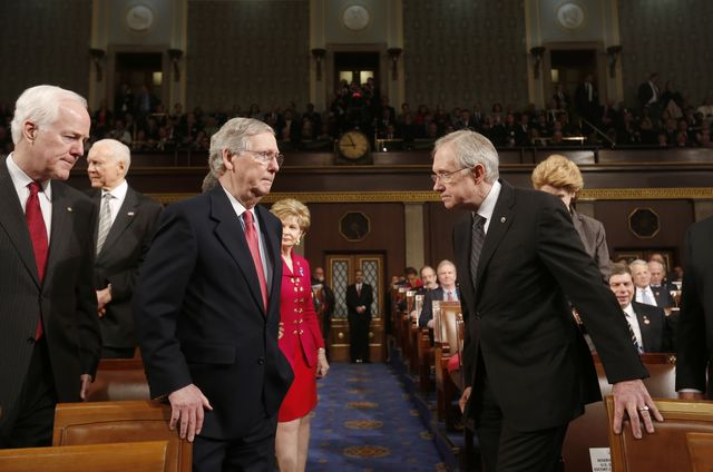 Mitch McConnelland Harry Reid, head-to-head. Will Republicans retake the Senate? Photographer: Larry Downing/Pool via Bloomberg